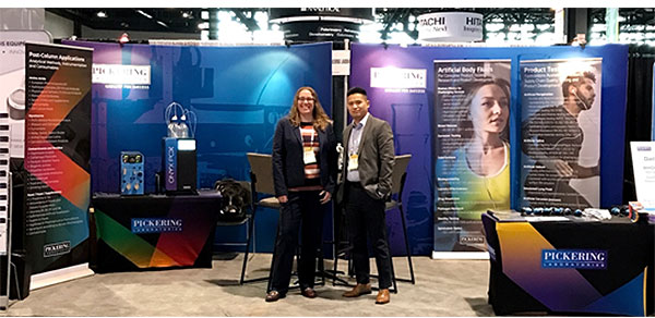 Rebecca Smith and Skip Vo showing off the colorful Pickering booth!