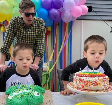 Kevin McKeown with his twin boys at their birthday party